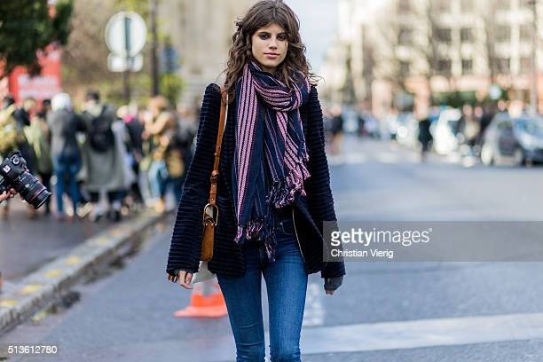 Model Antonina Petkovic wearing a navy jacket and denim jeans outside Chloe during the Paris Fashion Week Womenswear Fall/Winter 2016/2017 on March 3...