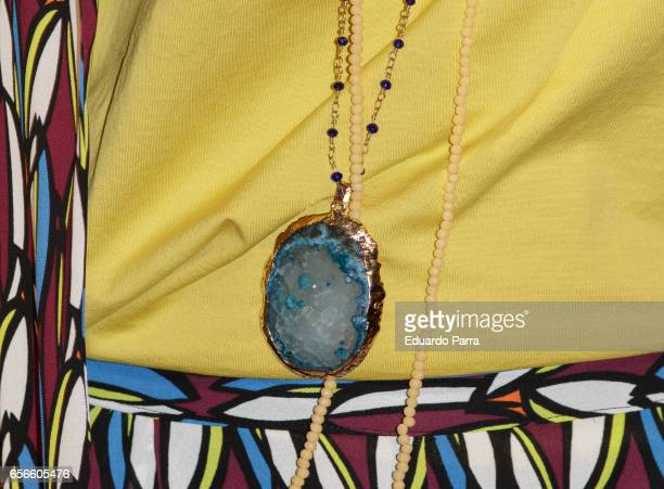 Model Arancha del Sol necklace detail attends the Juanjo Oliva's new collection parade at El Corte Ingles store on March 22 2017 in Madrid Spain