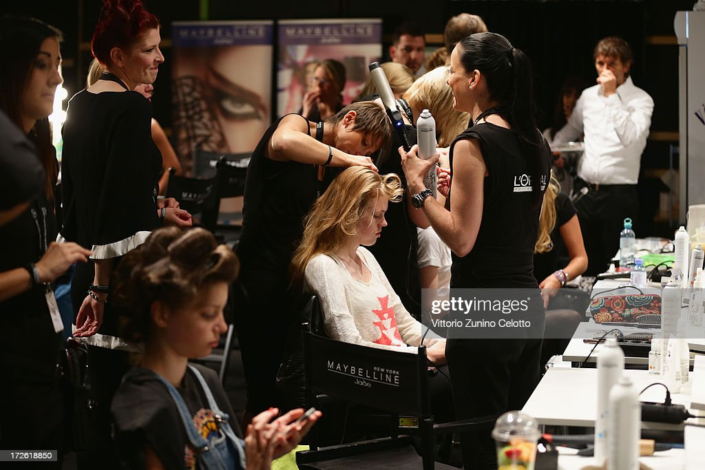 Model are getting styled backstage ahead of the Dietrich Emter Show during the Mercedes-Benz Fashion Week Spring/Summer 2014 at Brandenburg Gate on July 4, 2013 in Berlin, Germany