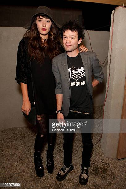 Model Ari Cooper and vocalist Deryck Whibley of Sum 41 attend the soft opening of The Writers Room on October 13 2011 in Los Angeles California