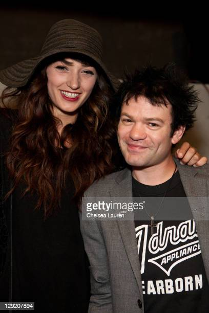Model Ariana Cooper and vocalist Deryck Whibley of Sum 41 attend the soft opening of The Writers Room on October 13 2011 in Los Angeles California