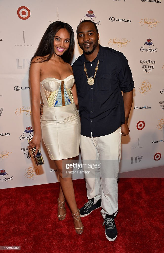 Model Ariel Meredith and football player Hakeem Nicks attend Club SI Swimsuit at LIV Nightclub hosted by Sports Illustrated at Fontainebleau Miami on February 19, 2014 in Miami Beach, Florida.