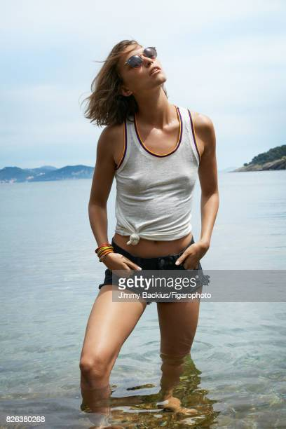 Model Arizona Muse poses for Madame Figaro on May 22 2017 in La Ciotat France Tank top shorts sunglasses earrings bracelets PUBLISHED IMAGE CREDIT...