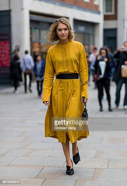 Model Arizona Muse wearing a mustard dress outside Topshop during London Fashion Week Spring/Summer collections 2017 on September 18 2016 in London...