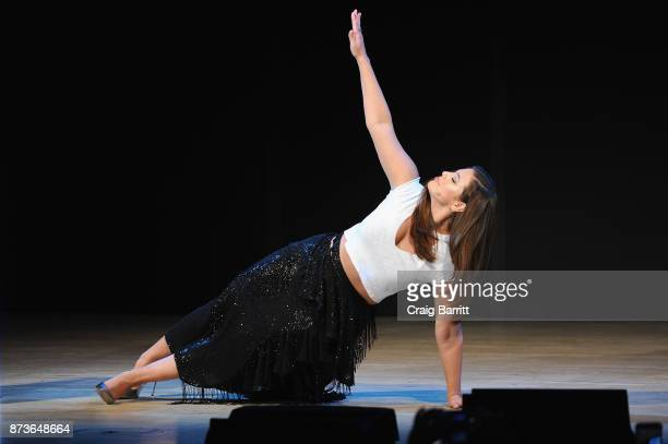 Model Ashley Graham does a side plank onstage as she hosts Glamour Celebrates 2017 Women Of The Year Live Summit at Brooklyn Museum on November 13...