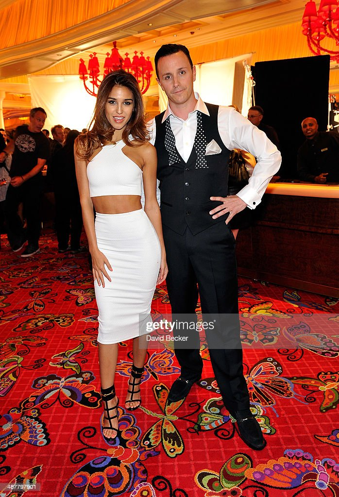 Model Ashley Sky (L) and Encore Beach Club, Surrender and Andrea's managing partner Sean Christie appear on the set of 'Paul Blart: Mall Cop 2' inside Encore at Wynn Las Vegas on May 1, 2014 in Las Vegas, Nevada.