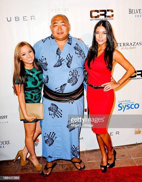 Model Ashley Villa Three time World Sumo Champion Byambajav Ulambayar and model Arianny Celeste arrive for the Bamboo Izakaya Restaurant Grand...