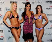 Model Ashton Wingo television personality Jenni 'JWoWW' Farley and model Melissa Richardson present creations by Farley during the unveiling of her...