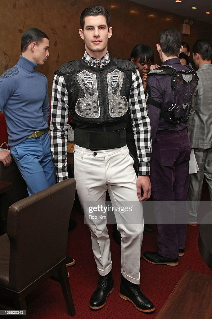 A model at first look backstage at the Marlon Gobel fall 2012 fashion show during MercedesBenz Fashion Week at Avery Fisher Hall Lincoln Center on...