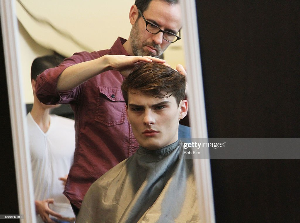 A model at hair and makeup backstage at the Marlon Gobel fall 2012 fashion show during MercedesBenz Fashion Week at Avery Fisher Hall Lincoln Center...