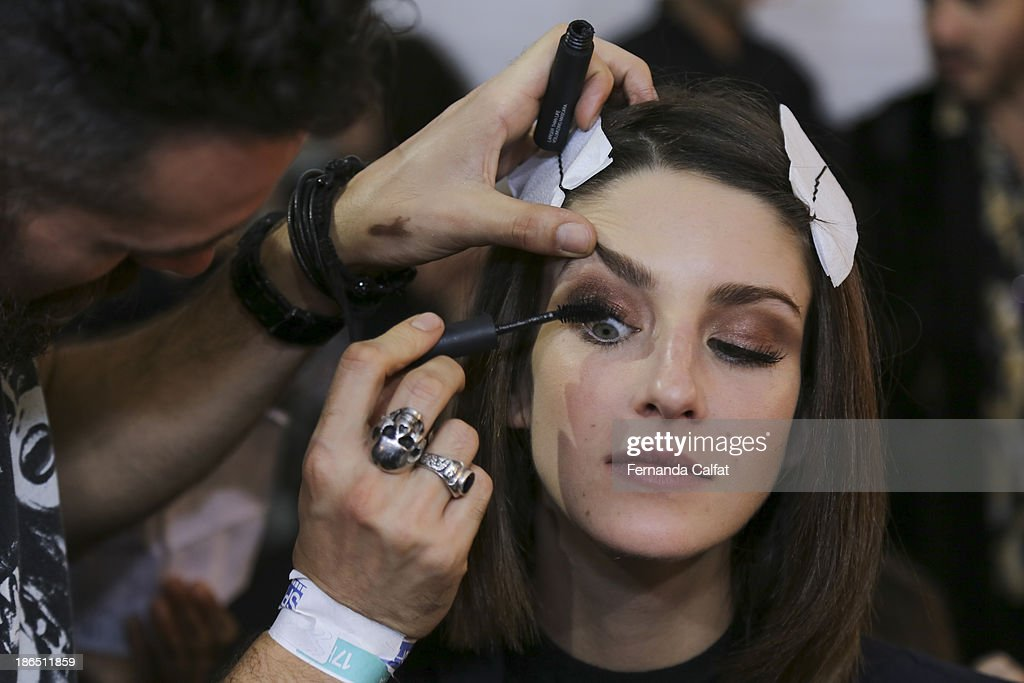 A model atends backstage the Colcci show at Sao Paulo Fashion Week Winter 2014 on October 31, 2013 in Sao Paulo, Brazil.