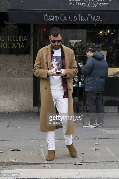 Model attends the Dolce amp Gabbana show during Milan Men's Fashion Week Fall/Winter 2017/18 on January 14 2017 in Milan Italy