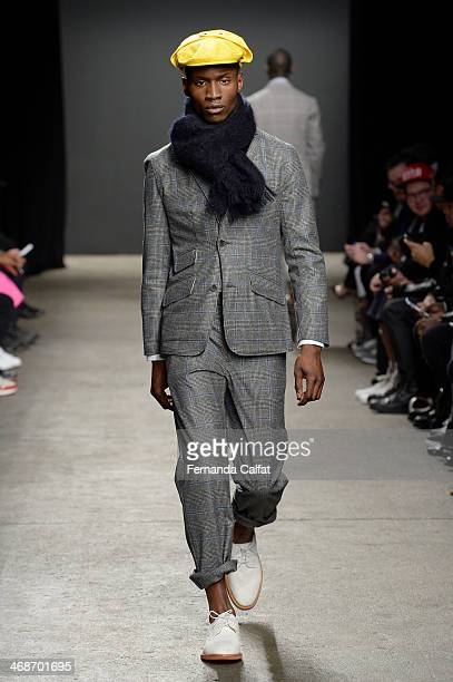 A model attends the Mark McNairy New Amsterdam runway during MercedesBenz Fashion Week Fall 2014 at Eyebeam on February 11 2014 in New York City