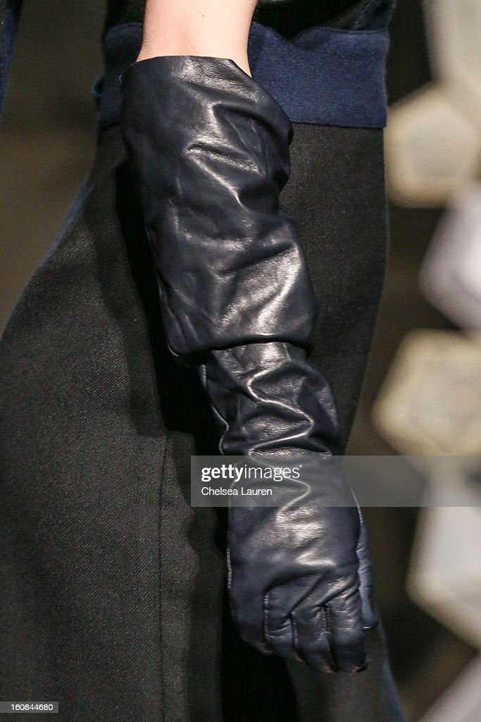 A model (glove detail) attends the Tia Cibani fall 2013 presentation during Mercedes-Benz Fashion Week at Baryshnikov Arts Center on February 6, 2013 in New York City.
