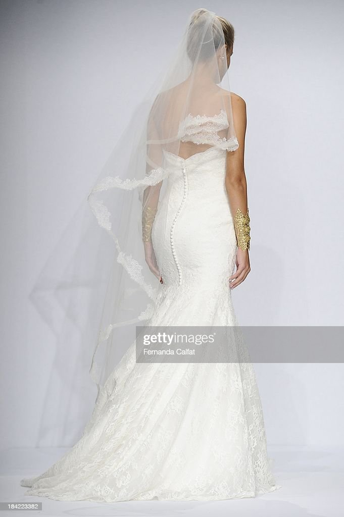 A Model attends the WTOO - Watters Fall 2014 Bridal collection show at the Hilton New York on October 12, 2013 in New York City.