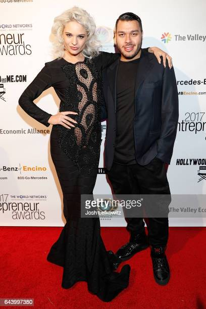 Model Ava Capra and fashion designer Adolfo Sanchez attend the 2017 Entrepreneur Awards at Allure Events And Catering on February 22 2017 in Van Nuys...