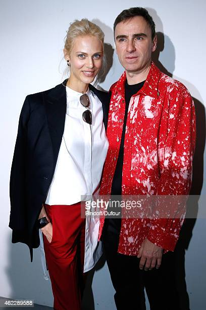 Model Aymeline Valade and Fashion Designer Raf Simons pose backstage after Christian Dior show as part of Paris Fashion Week HauteCouture...
