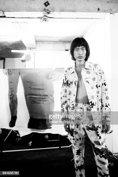 A model backstage ahead of the Alex Mullins show during the London Fashion Week Men's June 2017 collections on June 11 2017 in London England