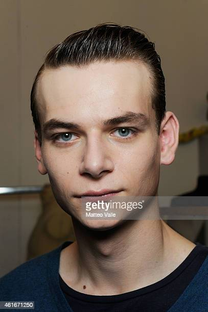 A model backstage ahead of the Andrea Pompilio show as a part of Milan Menswear Fashion Week Fall Winter 2015/2016 as during the on January 17 2015...