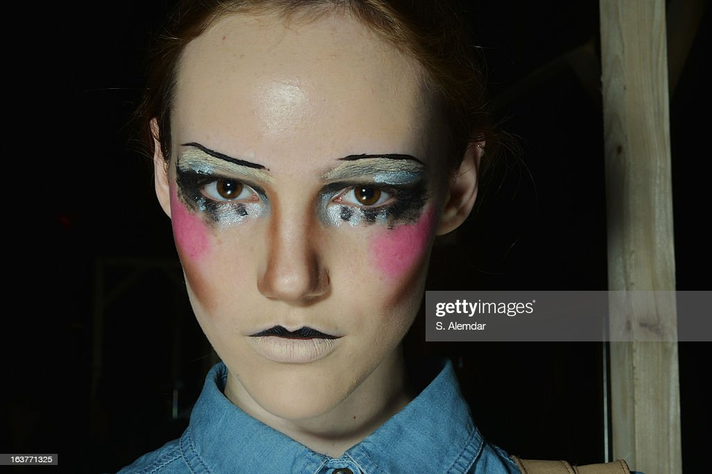 A model backstage ahead of the DB Berdan show during Mercedes-Benz Fashion Week Istanbul Fall/Winter 2013/14 at Antrepo 3 on March 15, 2013 in Istanbul, Turkey.