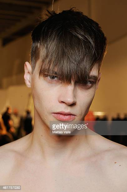 A model backstage ahead of the Diesel Black Gold show as a part of Milan Menswear Fashion Week Fall Winter 2015/2016 part of on January 19 2015 in...