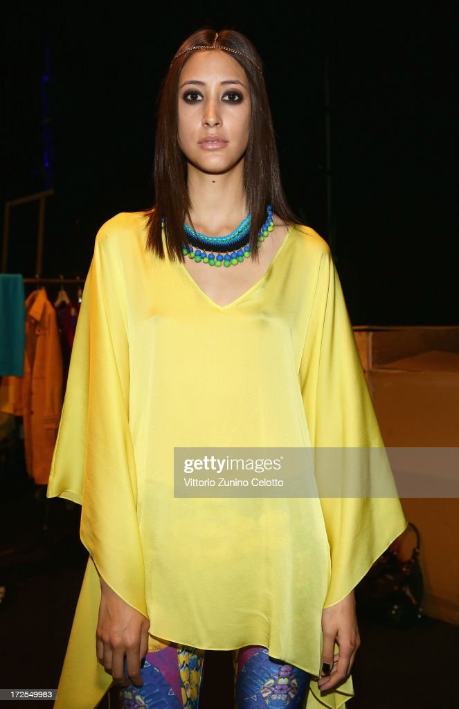 A model backstage ahead of the Dimitri show during Mercedes-Benz Fashion Week Spring/Summer 2014 at Brandenburg Gate on July 3, 2013 in Berlin, Germany.
