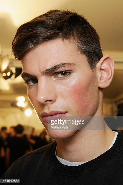 A model backstage ahead of the Dsquared2 Show during the Milan Menswear Fashion Week Fall Winter 2015/2016 on January 16 2015 in Milan Italy