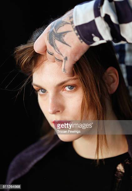 A model backstage ahead of the J JS Lee show during London Fashion Week Autumn/Winter 2016/17 at Brewer Street Car Park on February 19 2016 in London...