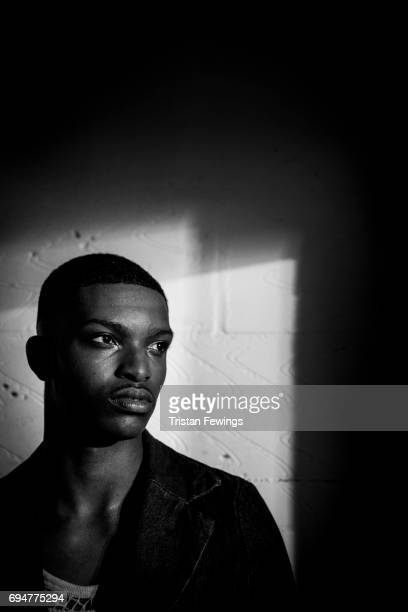 A model backstage ahead of the MAN show during the London Fashion Week Men's June 2017 collections on June 10 2017 in London England
