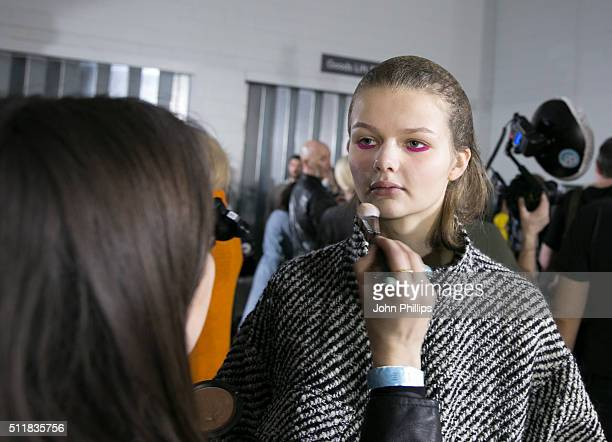 A model backstage ahead of the Marques'Almeida show during London Fashion Week Autumn/Winter 2016/17 at Olympia West on February 23 2016 in London...