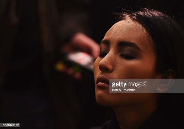 A model backstage ahead of the sass bide show during London Fashion Week Fall/Winter 2015/16 at Australia House on February 20 2015 in London England