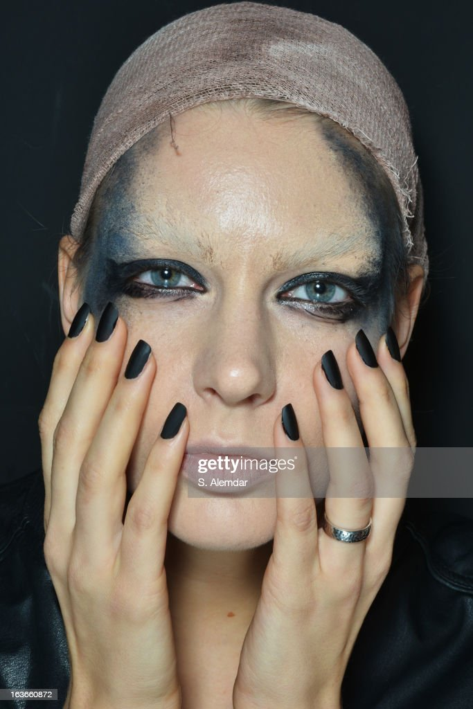 A model backstage ahead of the Tuba Ergin show during Mercedes-Benz Fashion Week Istanbul Fall/Winter 2013/14 at Antrepo 3 on March 14, 2013 in Istanbul, Turkey.