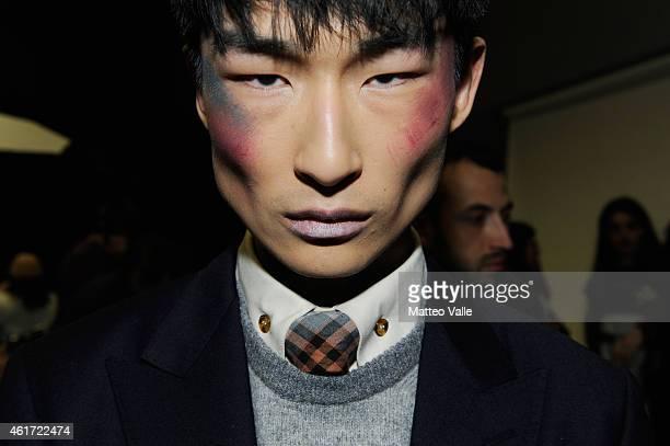 A model backstage ahead of the Vivienne Westwood show as a part of Milan Menswear Fashion Week Fall Winter 2015/2016 on January 18 2015 in Milan Italy
