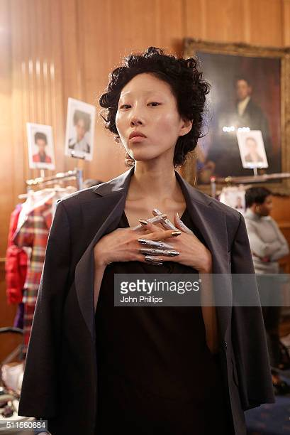 A model backstage ahead of the Vivienne Westwood show during London Fashion Week Autumn/Winter 2016/17 at Royal College of Surgeons on February 21...