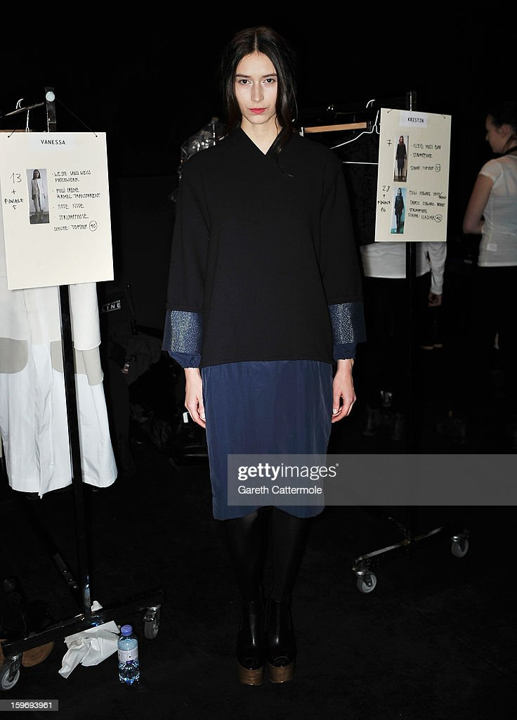 A model backstage ahead of the Vladimir Karaleev Autumn/Winter 2013/14 fashion show during Mercedes-Benz Fashion Week Berlin at Brandenburg Gate on January 18, 2013 in Berlin, Germany.