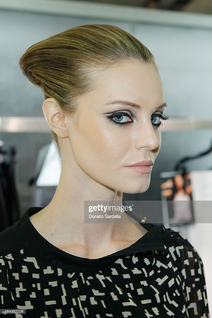 A model backstage at Saks Fifth Avenue presents designer Ralph Rucci at Saks Fifth Avenue Beverly Hills on March 22, 2013 in Beverly Hills, California.