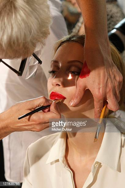 A model backstage at the Christian Dior Ready to Wear Spring / Summer 2012 show during Paris Fashion Week at Musee Rodin on September 30 2011 in...