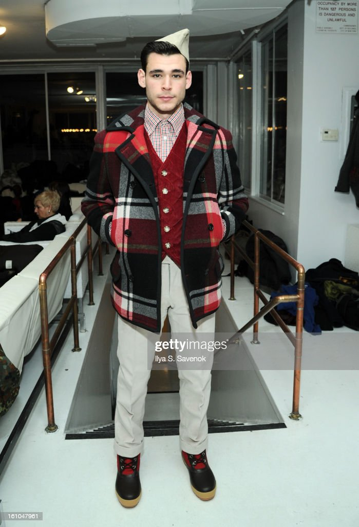 A model backstage at the Marlon Gobel fall 2013 fashion show during MercedesBenz Fashion Week at on February 8 2013 in New York City