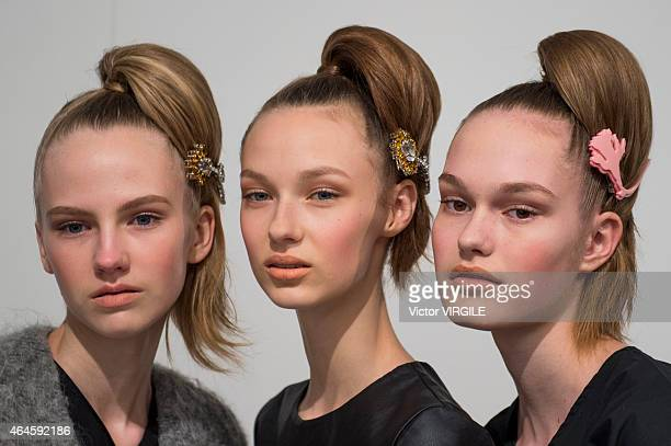 A model backstage at the Prada show during the Milan Fashion Week Autumn/Winter 2015 on February 26 2015 in Milan Italy