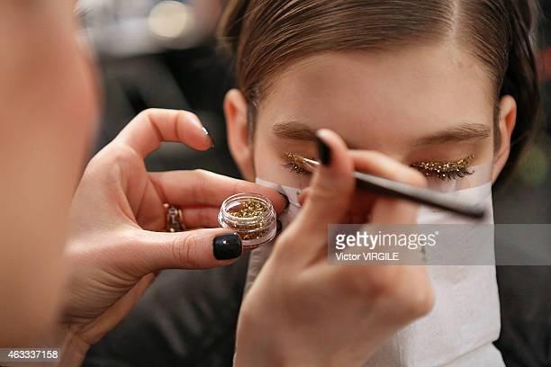 A model backstage at the Tadashi Shoji show during MercedesBenz Fashion Week Fall 2015 on February 12 2015 in New York City