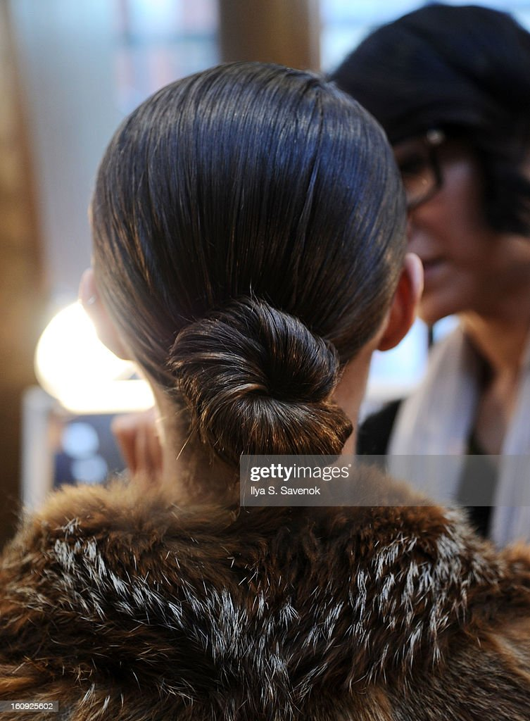 A model (hair detail) backstage during the La Perla fall 2013 presentation during Mercedes-Benz Fashion Week at The Gallery at The Dream Downtown Hotel on February 7, 2013 in New York City.