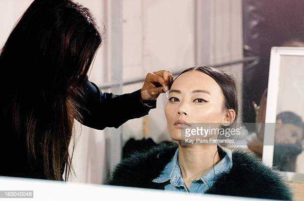 A model backstage during the Maison Rabih Kayrouz Fall/Winter 2013 ReadytoWear show as part of Paris Fashion Week at the Palais De Tokyo on March 3...