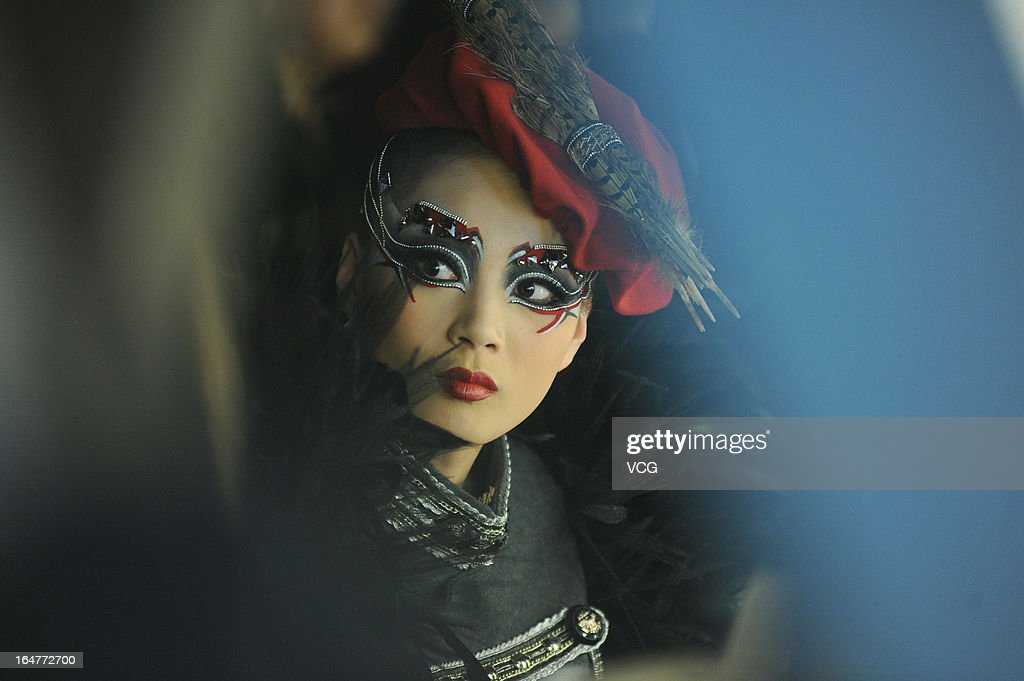 A model backstage during the MGPIN collection show on the fourth day of Mercedes-Benz China Fashion Week Autumn/Winter 2013/2014 at 751 D.PARK Workshop on March 27, 2013 in Beijing, China.