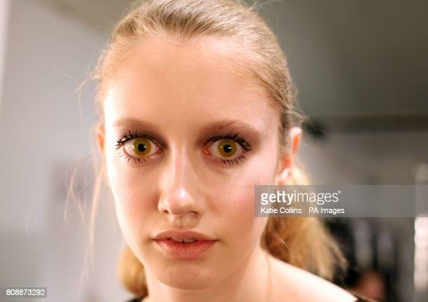 A model backstage wearing yellow contact lenses at the Aminaka Wilmont Autumn/Winter 2011 show at London Fashion WeekPicture dateFriday February 18...