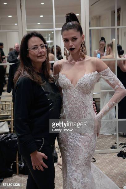 A model backstage with the creative director at the Berta Runway show during New York Fashion Week Bridal April 2017 at The Plaza Hotel on April 21...