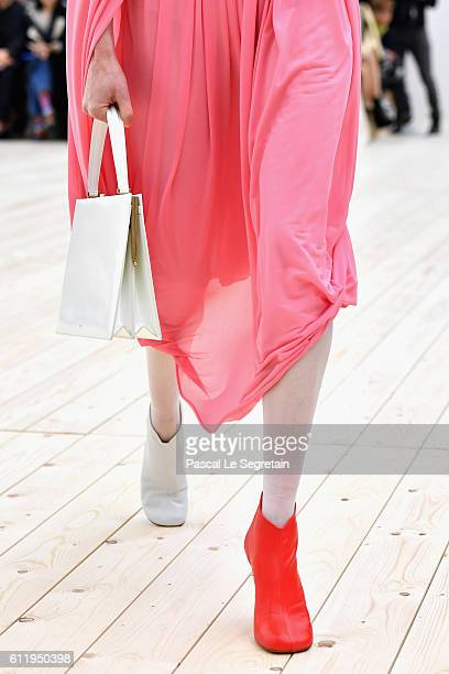 A model bag and boots detail walks the runway during the Celine show as part of the Paris Fashion Week Womenswear Spring/Summer 2017 on October 2...