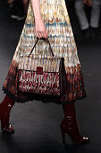 A model bag and shoe detail walks the runway during the Valentino show as part of the Paris Fashion Week Womenswear Fall/Winter 2015/2016 on March 10...
