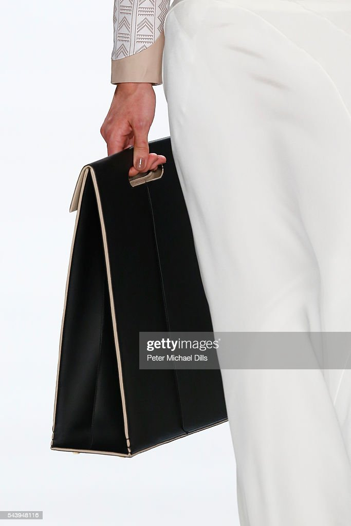 A model, bag detail, walks the runway at the Maisonnoee show during the Mercedes-Benz Fashion Week Berlin Spring/Summer 2017 at Erika Hess Eisstadion on June 30, 2016 in Berlin, Germany.
