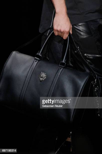 A model bag detail walks the runway at the Wolftotem show during Milan Men's Fashion Week Spring/Summer 2018 on June 18 2017 in Milan Italy