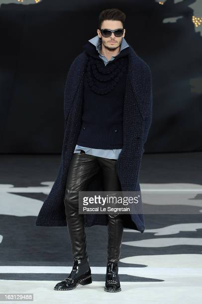 Model Baptiste Giabiconi walks the runway during Chanel Fall/Winter 2013 ReadytoWear show as part of Paris Fashion Week at Grand Palais on March 5...